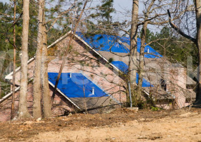 Tornado damaged house with a Flexitank tarpaulin on the roof