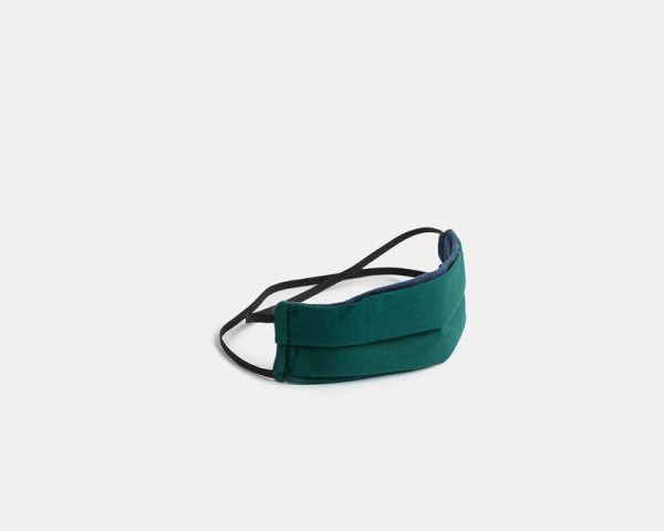 Reusable facemask pleated green cotton stock photo
